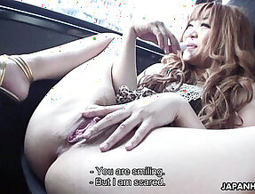 Delicious Japanese gal masturbating in a car